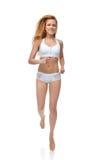 Movimentar-se e runni magros bonitos da mulher do esporte da aptidão nova feliz imagem de stock royalty free