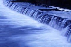 Movimento di caduta dell'acqua Fotografia Stock
