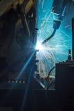 Movimento dos robôs de soldadura Fotografia de Stock
