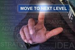 Movimento tocante do homem de negócios nivelar em seguida o botão na tela virtual Fotos de Stock Royalty Free