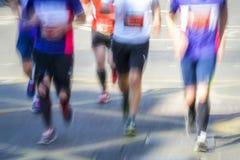 Movimiento borroso del grupo de corredores de maratón Imágenes de archivo libres de regalías