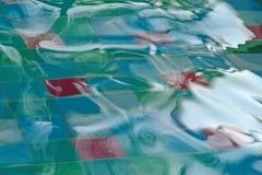 Movimiento colorido del agua de la falta de definición Imagen de archivo