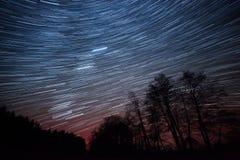 movimiento de estrellas alrededor de la estrella de poste Fotos de archivo libres de regalías