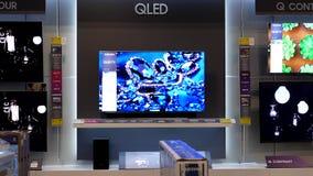 Movimiento de la exhibición TV en venta almacen de video