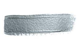 Movimiento de plata de la brocha del brillo o mancha abstracta del lenguado con textura de la mancha en el fondo blanco El brilla Fotos de archivo libres de regalías