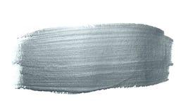 Movimiento de plata de la brocha del brillo o mancha abstracta del lenguado con textura de la mancha en el fondo blanco Sil chisp Fotos de archivo