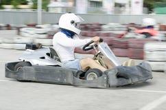Movimiento del conductor de Karting azulado fotografía de archivo libre de regalías