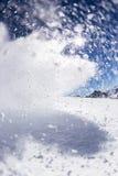 Movimiento del helada de la nieve del polvo que arruina hacia fuera Imagen de archivo libre de regalías
