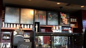 Movimiento del menú de Starbucks en la pared