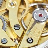 Movimiento mecánico de cobre amarillo del reloj retro Foto de archivo