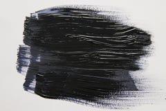 Movimiento negro del cepillo de la acuarela sobre el fondo blanco imágenes de archivo libres de regalías