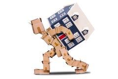 Moving концепция человека коробки дома Стоковые Фотографии RF