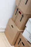 Moving. Boxes and possessions on the floor Stock Photography