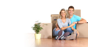 Moving. Young couple sitting on the floor after moving Stock Photography