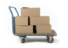 Moving. Brown boxes on a trolley stock photography