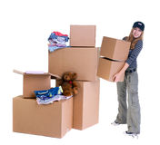 Moving. A young teenager packs up her room, time for another change and a new home Royalty Free Stock Photos