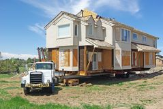 Moving. A house loaded onto a truck about to be moved Stock Photography