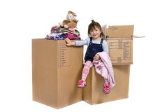 Moving. A young asian girl packing up her room Stock Photo