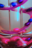 Moving Abstract. Abstract of a lamp with marbles moving along a swirling track stock image