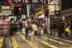 Moving activity on busy street scene in city Stock Images