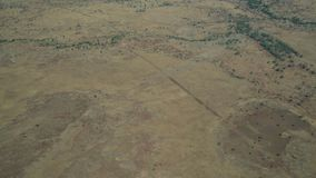 Drone shot of the Australian outback. A moving aeriel drone shot of the dry Australian outback littered with bushes and dry dirt stock footage