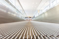 Moving airport slidewalk Stock Photos
