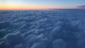 View Out the Airplane Window Blue Clouds Over Alaska stock video footage
