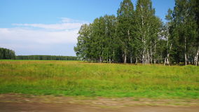Moving along a scenic agricultural fields (time-lapse). TIME-LAPSE: Moving along a scenic agricultural fields and forest in Altai, Russia (POV stock video