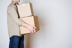 Moving: Anonymous Man Carrying Cardboard Moving Boxes Royalty Free Stock Photography