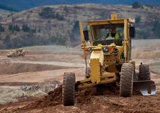 moving arbete för jordutrustning Arkivbild