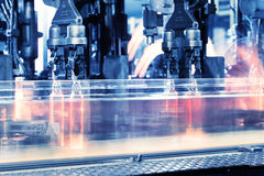 Moving assembly line for production of bottles Royalty Free Stock Images
