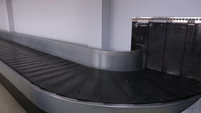 A moving baggage carousel or conveyor belt closeup. This device, located in arrival hall of airport, is designed to deliver baggage of passengers. Is an stock video