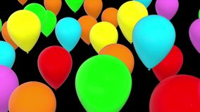 Moving balloons in various colors on black