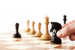 Moving black chess knight on a chessboard Royalty Free Stock Images