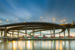 Moving blue sky cloud waterfront over round highway intersection. Stock Images