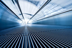 Moving blue travolator in airport Stock Photography