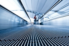 Moving blue travolator in airport Royalty Free Stock Photos