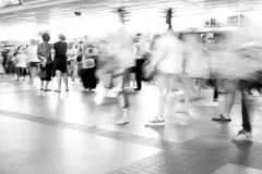 Moving blur people walking - black and white effect. Moving blur people walking in railway station - black and white effect Stock Photography