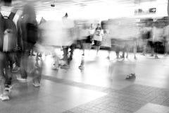 Moving blur people walking - black and white effect. Moving blur people walking in railway station - black and white effect Royalty Free Stock Photo