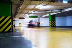 Moving blurred car in parking garage Royalty Free Stock Image