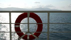 Moving boat with life ring buoy stock video footage