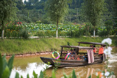 Moving boat in lotus village Stock Photography