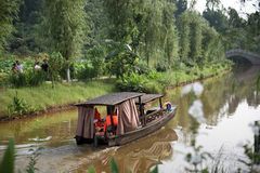 Moving boat in lotus village Royalty Free Stock Images