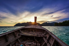 Moving at boat in the tropical sea to sunset Stock Photography