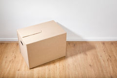 Moving Box on the Floor Stock Photography