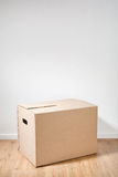 Moving Box Next to a Wall Royalty Free Stock Images