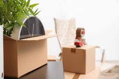 Moving box with office stuff on table indoors. Closeup royalty free stock photos