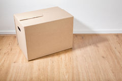 Moving Box in a Room Stock Images