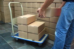 Moving boxes. From the cart Royalty Free Stock Photography