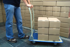 Moving boxes. Stacked on cart Royalty Free Stock Images